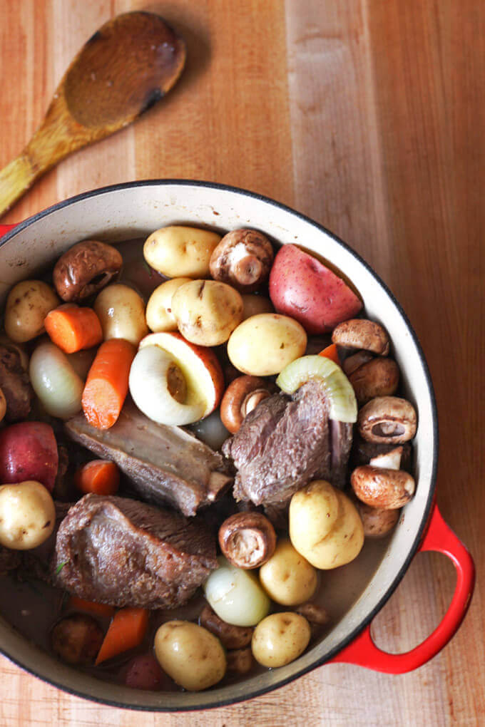 Beef stew filled with all the winter comforts. Tender meat, loaded with winter veg, & an extra kick from the horseradish. A great meal to bring family and friends together| breakingbreadwithashley.com