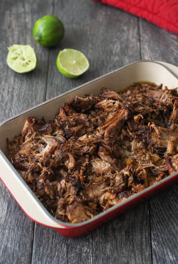 Pulled pork packed with spices of coriander, cumin, mustard & others. Bursting with flavors. Relax while your slow cooker or/Instant pot does the work | www.breakingbreadwithashley.com