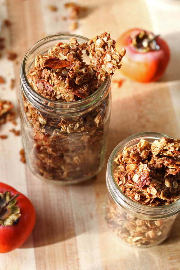 Persimmon and Spiced granola sweetened with honey and molasses. Watch out as this stuff can be incredibily addictive!| www.breakingbreadwithashley.com