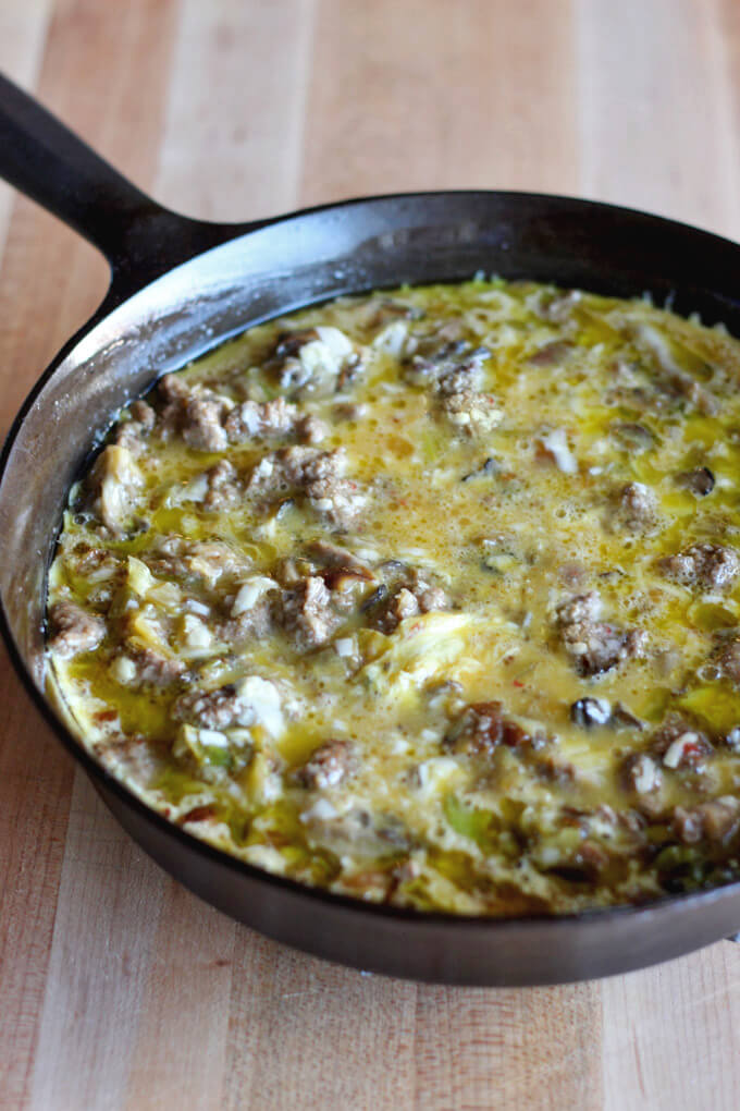 Sausage, leek, and mushroom frittata before baking in oven.