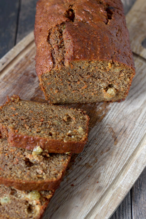 Slices of Olive Oil Carrot bread. Whole wheat flour makes for darker loaf but orange specks from carrot along with orange zest, spices, and buttermilk brighten the loaf and keep it moist.