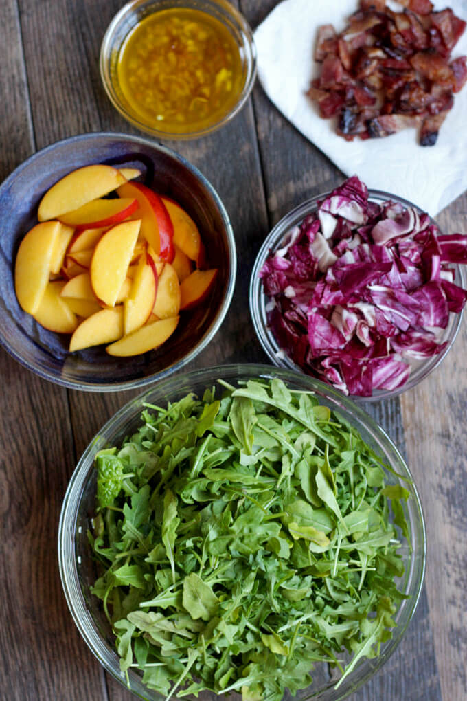 Ingredients in bowls for Nectarine, Radicchio, and Arugula Salad