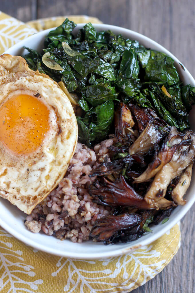 Close up on Kale, Mushroom, and Sausage Wild Rice Bowl on yellow patterned cloth