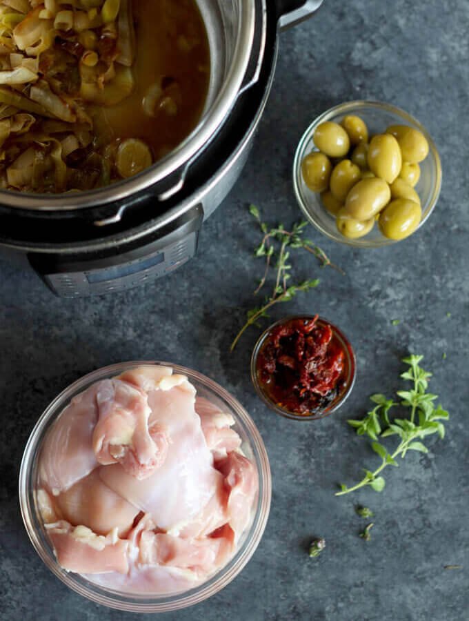 Instant Pot Leek and Olive Chicken ingredients on asphalt surface